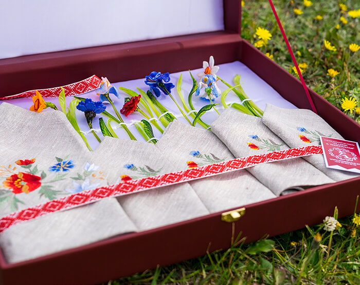 glass flowers in a red box